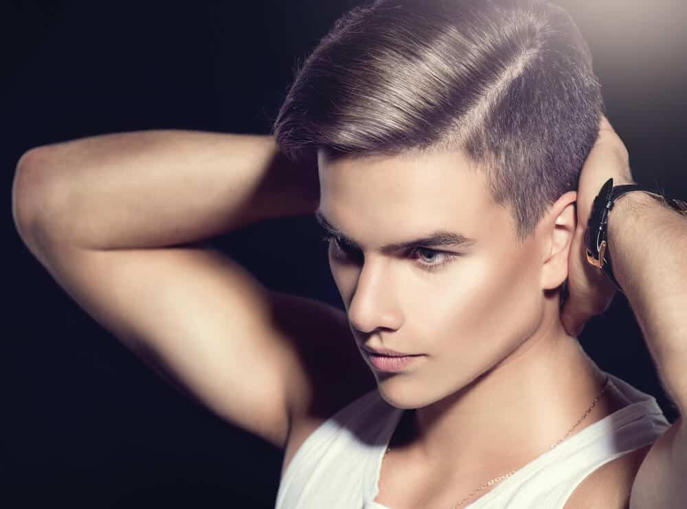 A young model with a side-part hairstyle.