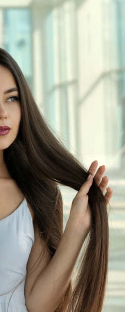 Brunette with .long and straight hair.