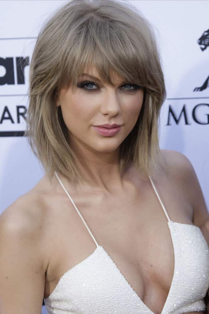 Taylor Swift in a bob cut with bangs.