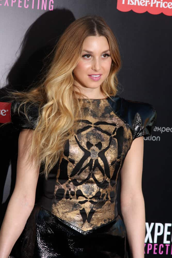 Whitney Port exhibiting her long, blonde hair with ombre highlights.