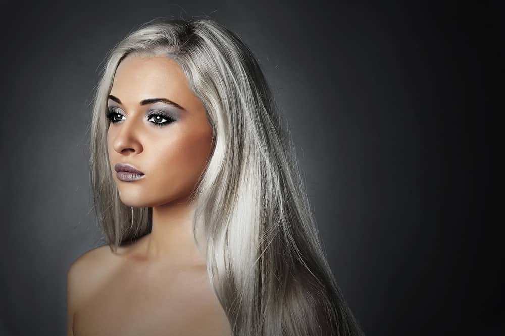 Example of woman with metallic silver hair coloring.