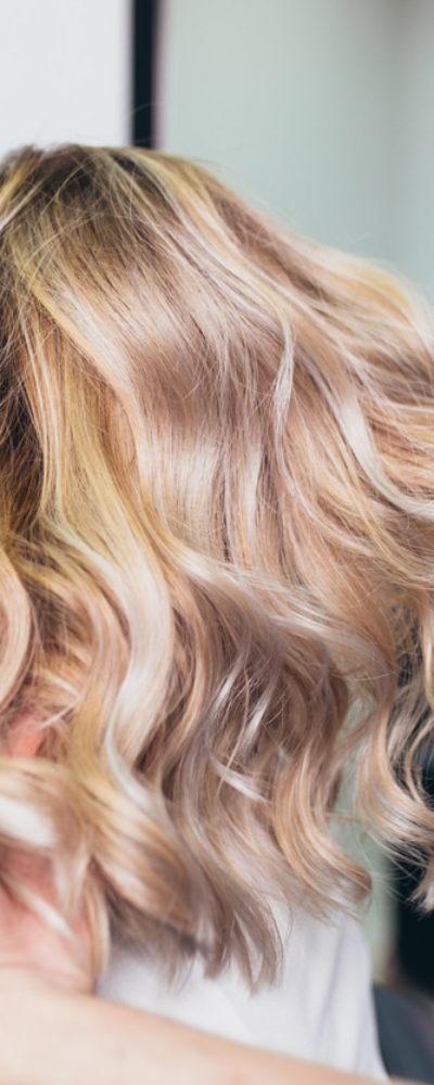 Woman with blonde fine hair at hair salon