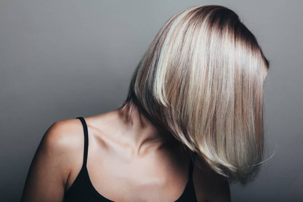 Accented ash blonde stacked bob hair.