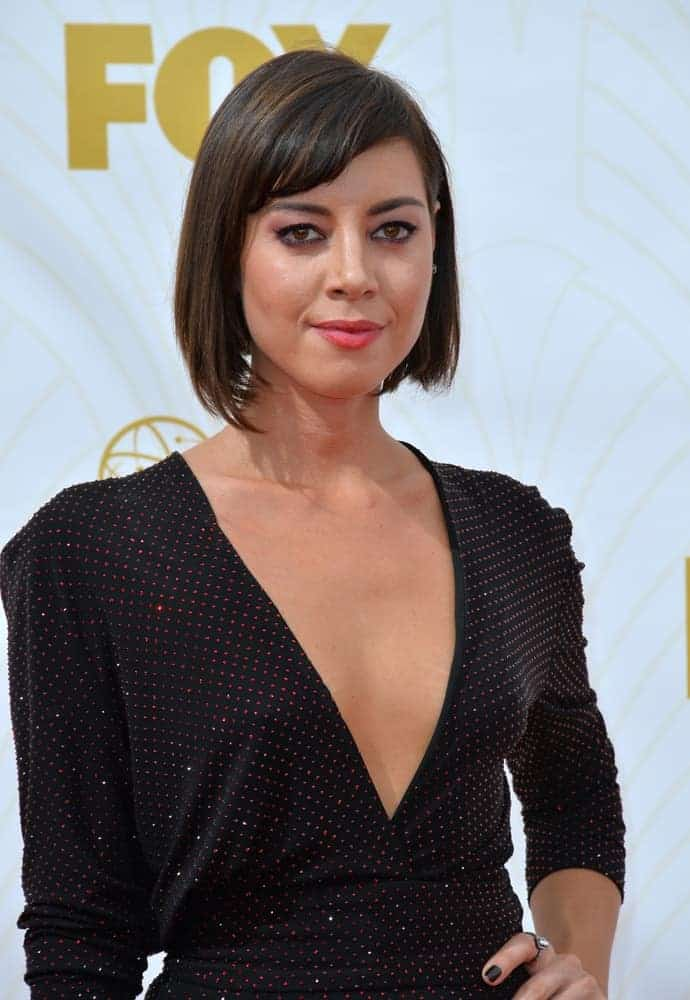 On September 20, 2015, Aubrey Plaza was at the 67th Primetime Emmy Awards at the Microsoft Theatre LA Live. She paired her stunning black dress with a chin-length raven bob hairstyle with short layered bangs.