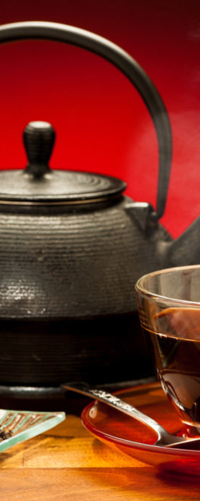 Photo of black tea and kettle