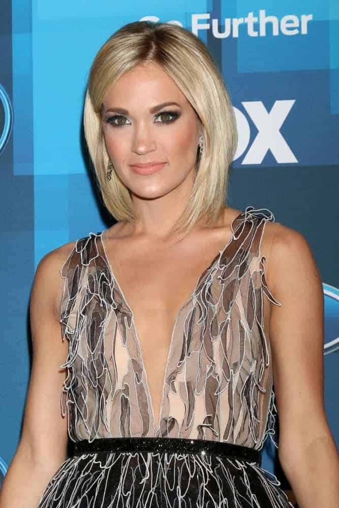 Carrie Underwood chopped her hair into a bob for a more sleek and sophisticated look as she attends the American Idol FINALE Arrivals on April 7, 2016.