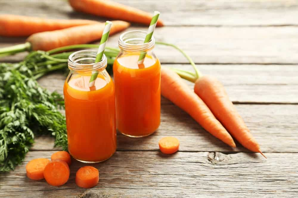 Two glasses of fresh carrot juice.