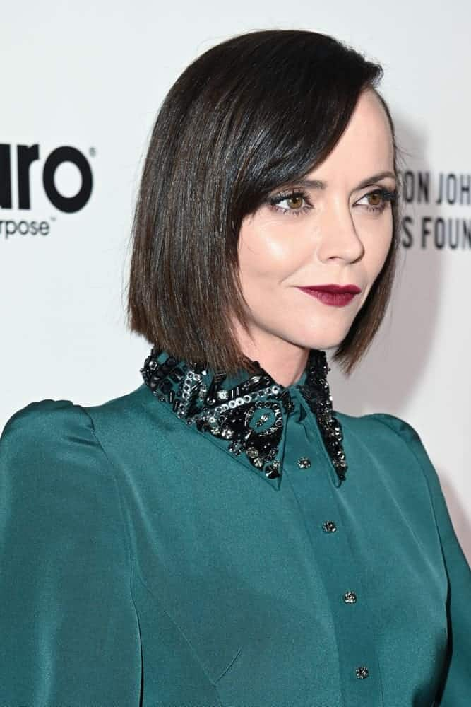 Christina Ricci was at the red carpet of the Elton John AIDS Foundation Party on February 09, 2020, in Los Angeles, California. She was seen in an elegant green dress that she paired with a straight raven chin-length hairstyle with side-swept bangs.