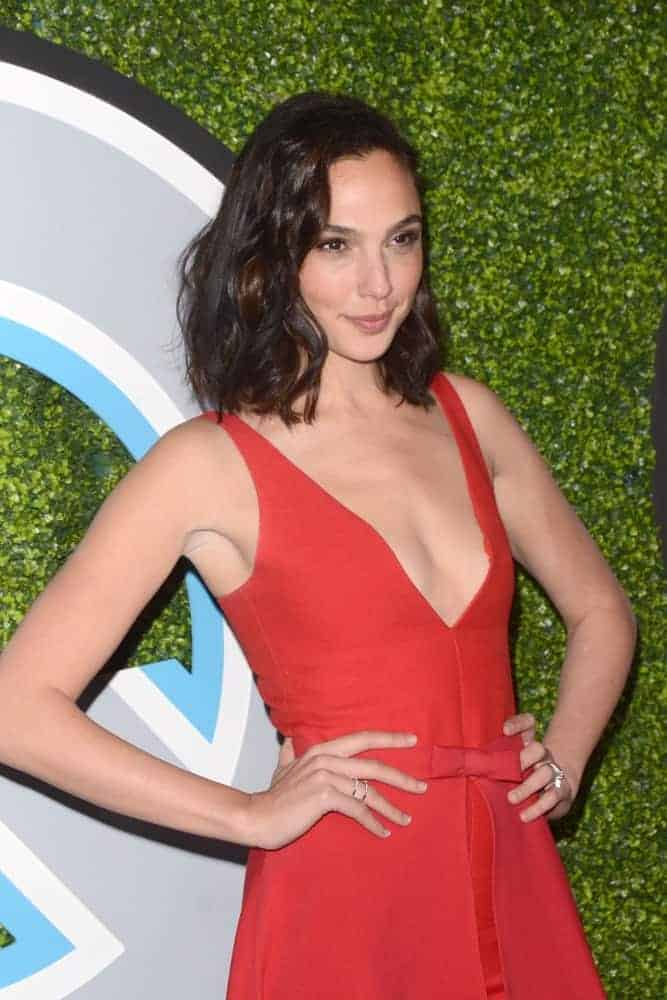 Gal Gadot attended the 2017 GQ Men of the Year at the Chateau Marmont on December 7, 2017, in West Hollywood, CA. She paired her lovely red dress with a shoulder-length tousled wavy hairstyle.