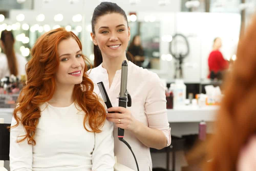 Ginger salon's stylist with a woman client with ginger hair.