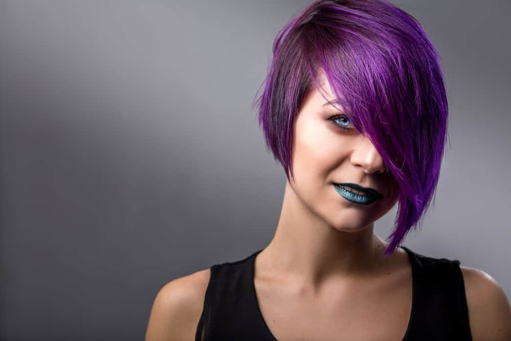 Pixie cut dyed in strong purple color.