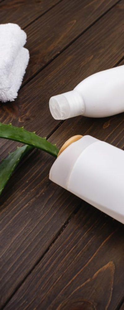 Shampoo for color-treated hair on a hardwood table.