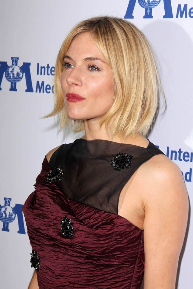 Sienna Miller chopped off her blonde highlighted locks into a straight bob during the International Medical Corps 2014 Annual Awards Celebration held on October 23, 2014.