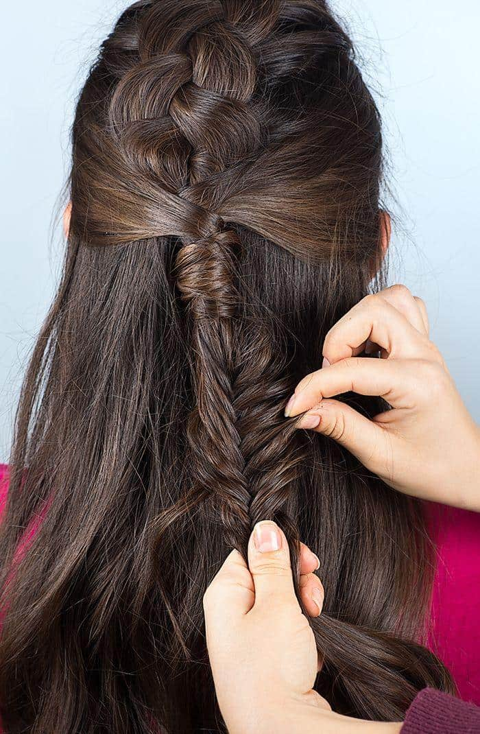 Step 9: Finish the fishtail braid and pull on each strand in order to loosen the braid and create a more relaxed look.