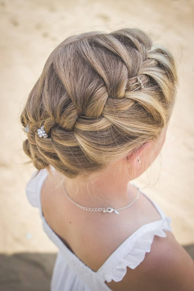 The side braid hairstyle with blonde color.