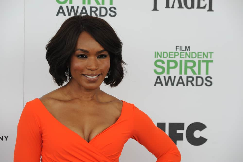 This hairstyle modeled by actress Angela Bassett is a bronze-chocolate bob-length style. Along with its short length, the hairstyle is supplemented with voluminous and curled layers in order to frame the face of its wearer. This style will bring out one's facial features by framing them nicely.
