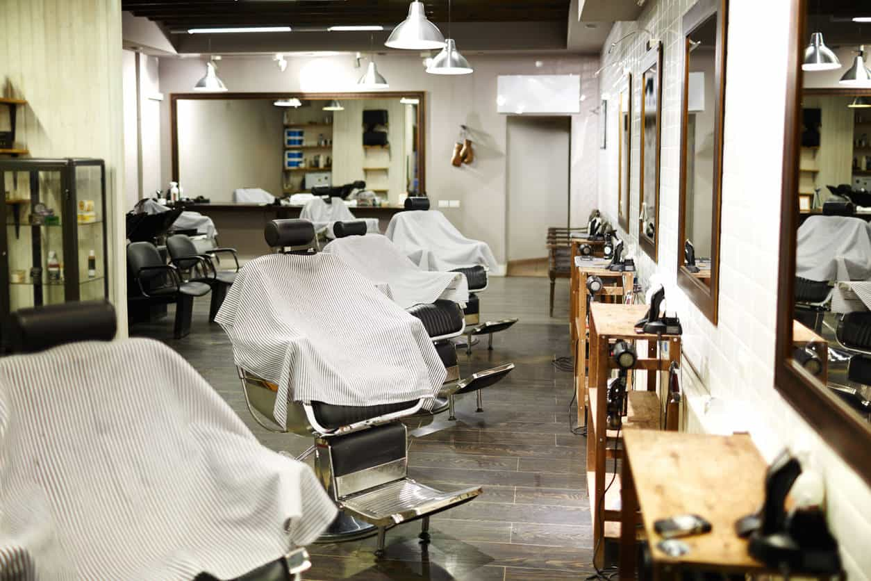 It doesn't take much to create a fabulous barber shop space. Check this one out. It's pretty simple design-wise. There are some nice pendant lights, inexpensive station cabinets, mirrors and a line of chairs. That's it, yet I think it looks great.