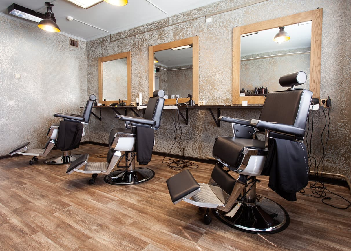 Here's a light and bright barbershop with distressed looking walls against a wood floor. Frankly, I don't like the walls at all, but included this design because you might. They are unique for sure.