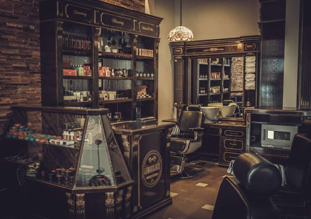 Here's a larger view of the above barber shop. Look at the detail in this vintage shop. The display case, cash register area, woodwork, old brick, Tifanny chandelier. This is one amazing design.