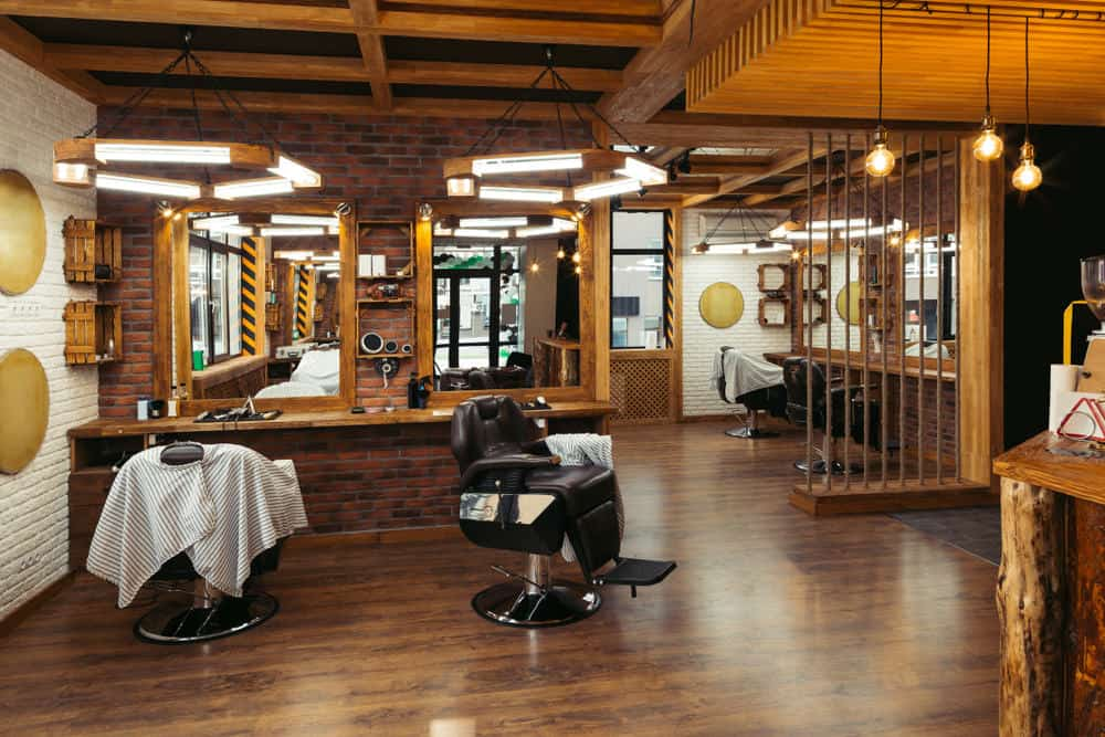 Larger view of the barbershop above. It has several station sections and certainly isn't crowded. You could easily add more stations to this space. The rustic design is great.