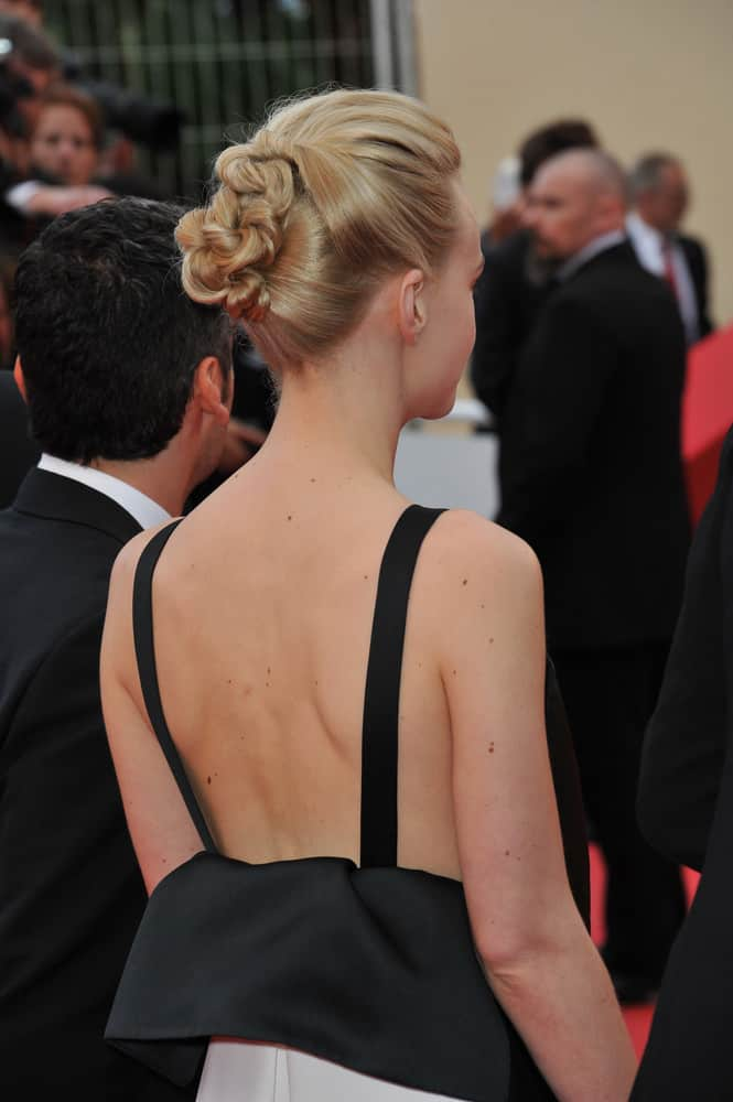 You'd never know that Carey Mulligan has short hair with this style. If your hair is too short to pull back into one bun, try a couple! Twisting pieces back keeps them from falling out. Just use plenty of pins to secure each bun in place.