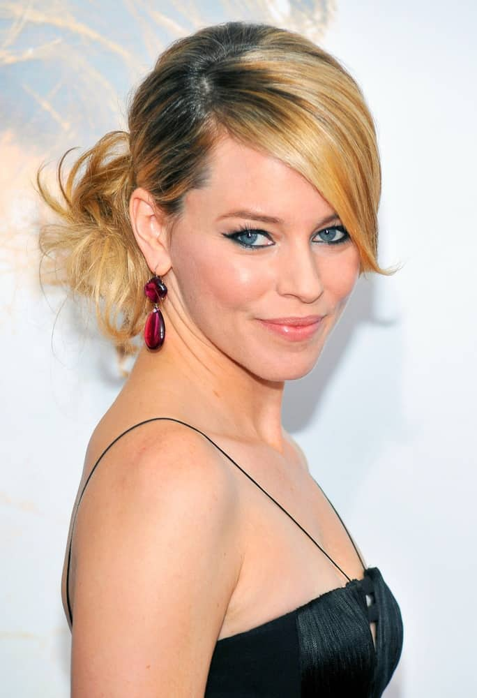 Elizabeth Banks is no stranger to daring style, and this up-do is no exception. Use a deep side part in the front and smooth the hair. Wrap the ends into a low bun, but instead of tucking the ends under pull them out and fan them a bit. Finish with some texture paste to separate the ends.