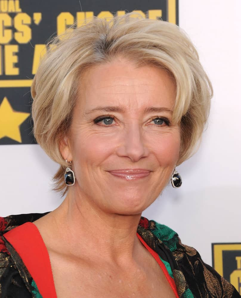 In this next hairstyle, modeled by Emma Thompson, it features a short-cut length that touches the nape of the neck. This short hairstyle is complemented by a light blonde color, in addition to slivers of silver highlights. In order to frame the face of the wearer and add volume, curls are added away from the face.
