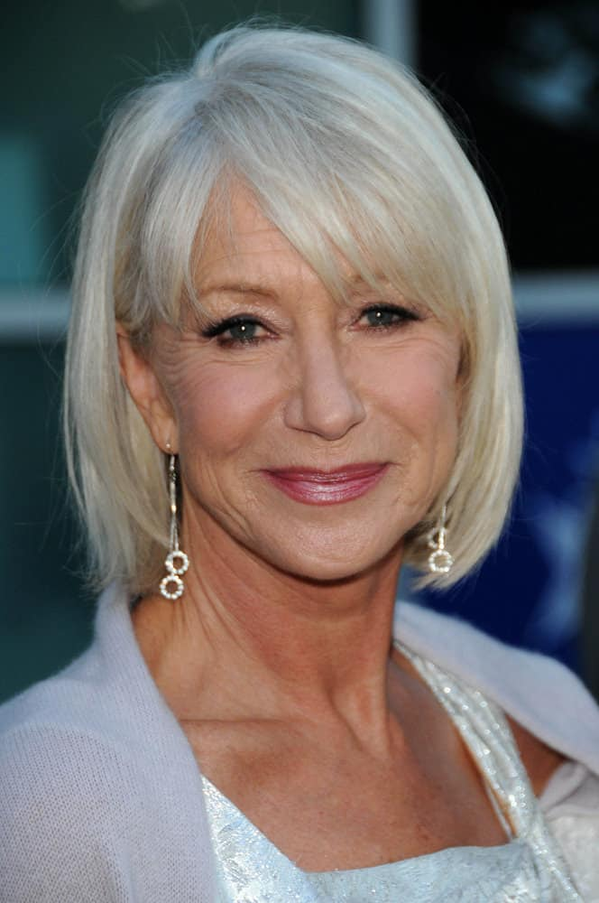 This twelfth hairstyle modeled by Helen Mirren features a soft, silver-colored bob that is softly curled inwards, towards the face, at the ends of the hair strands. In addition to the classy, silver hair color, the style features tousled, tapered-cut bangs that hang in different directions of the face.