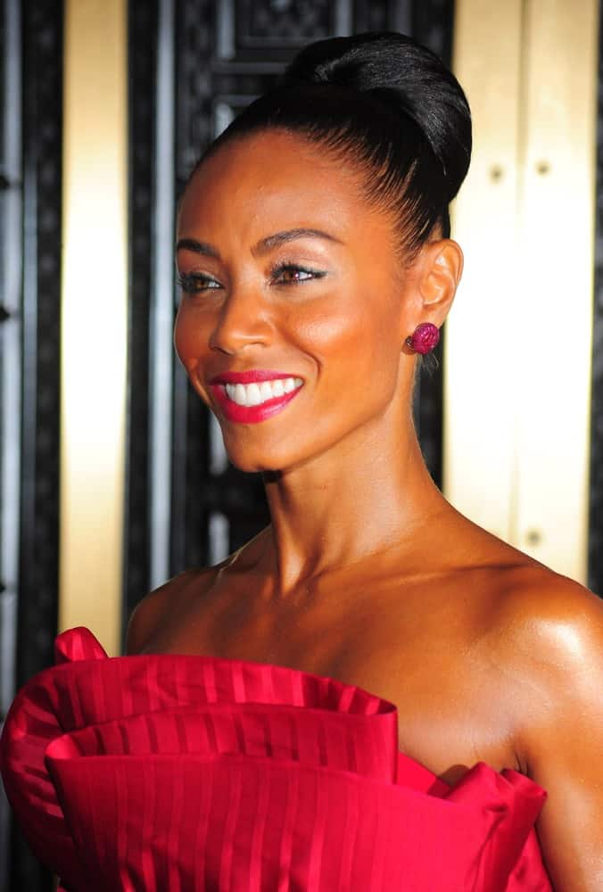 If you like bold fashion like Jada Pinkett-Smith's red dress then a simple up-do is all you need. Brush back into a tight ponytail, then gently twist as you wrap the hair around to create a classic ballet bun. Tuck in the ends and use a rattail comb to gently loosen the bun and add volume.