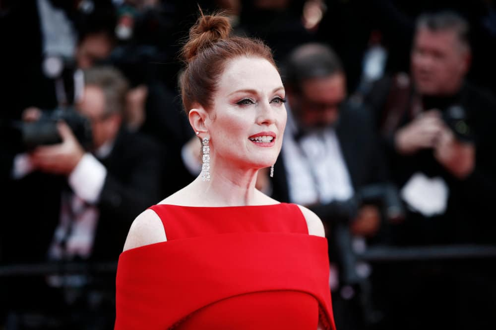 The ninth hairstyle is portrayed by actress Julianne Moore. She models a messy and muted red and auburn-colored top-knot. This hairstyle best complements those with high cheekbones and strong face shapes.