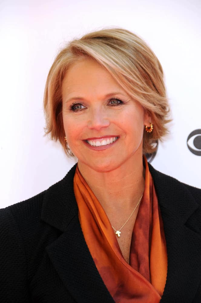 This eighth hairstyle is modeled by Katie Couric. The style features a light blonde color, complemented by chestnut-colored highlights. The style can be seen as a longer form of the well-known pixie cut and is supplemented by the short layers of the hair being curled away from the face.