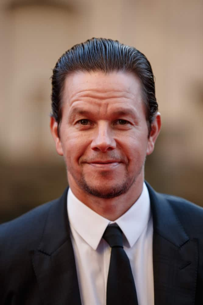 Mark Wahlberg with slicked back hair arrives on the red carpet at the Transformers The Last Knight movie premiere on June 20, 2017 in Chicago