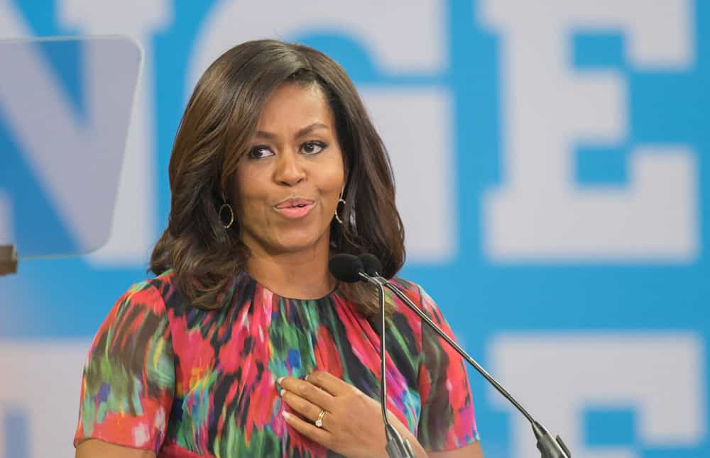 Michelle Obama with shoulder-length side-parted hair speaking to students at NC State University dec13