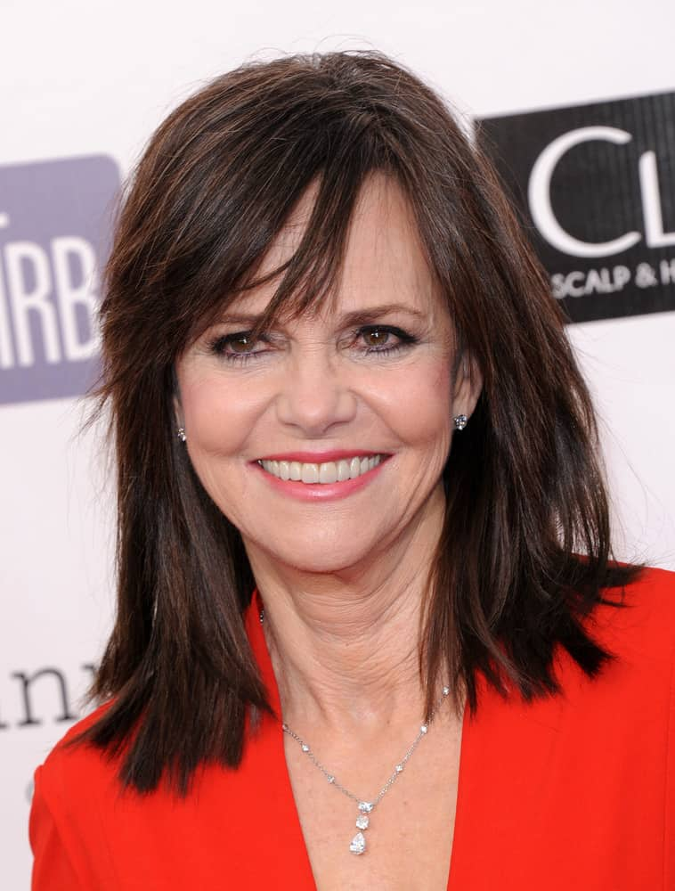 The fourth hairstyle is modeled by actress Sally Field. The style features blunt cuts in order to add dimension and volume to each section of the hairstyle. In addition, the style's rich brunette color, with slight and small auburn highlights add vibrancy to the hairstyle, which might aid in making the wearer appear more youthful.