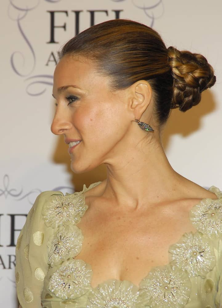 Leave it to Sarah Jessica Parker to inspire yet another fashion choice. This braided bun is worthy of a princess. Brush your hair back into a ponytail making sure your hair is nice and smooth. Braid the pony and wrap it around the base. Secure with pins all around and tuck the ends under the bun.