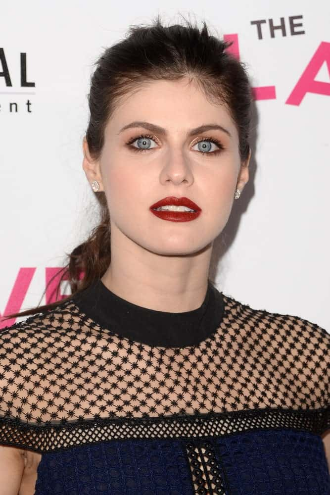 """Alexandra Daddario pulled her hair back to a high ponytail for """"The Layover"""" Los Angeles Premiere held on August 23, 2017."""