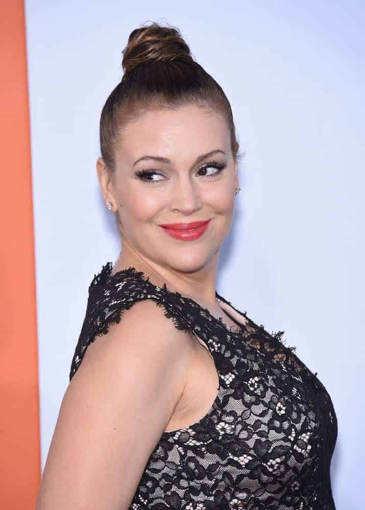 "Alyssa Milano slicked back her brunette tresses into a high twisted knot for the ""Get Hard"" Los Angeles Premiere on March 25, 2015."