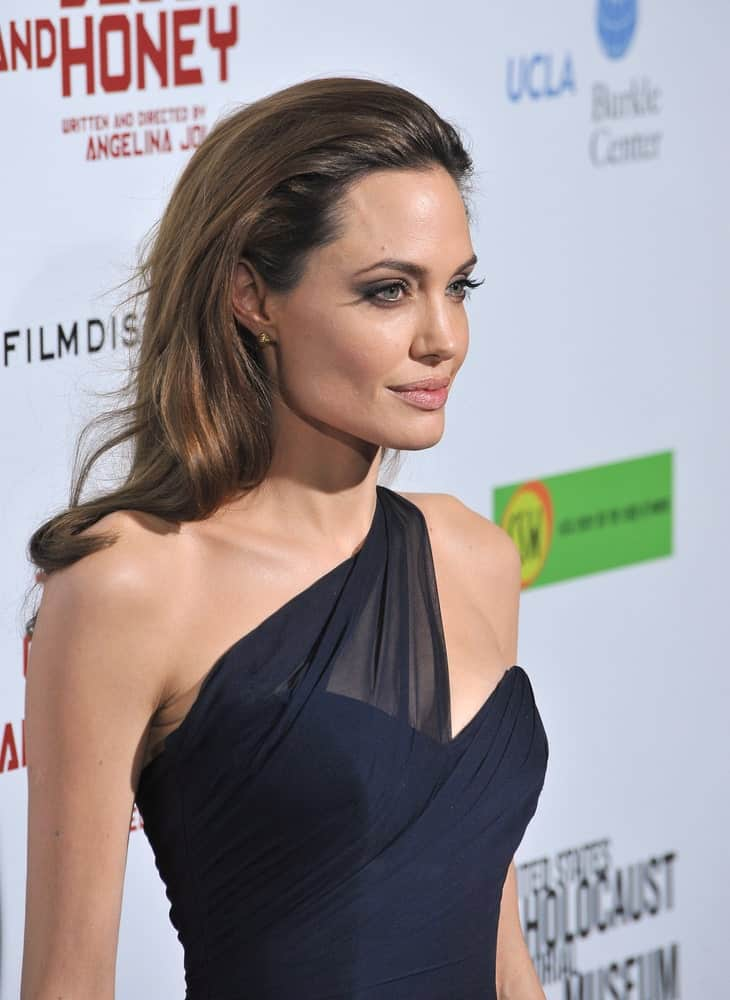 """Angelina Jolie went with an elegant slicked-back long hairstyle with waves at the tips to match her black dress at the Los Angeles premiere of her new movie """"In The Land of Blood and Honey"""" at the ArcLight Theatre, Hollywood on December 8, 2011, in Los Angeles, CA."""