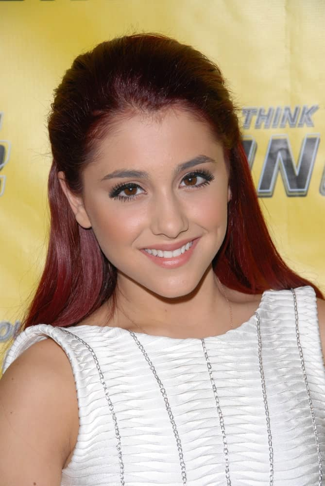 Ariana Grande styled her long, red tresses with a loose, brushed back hairstyle during the