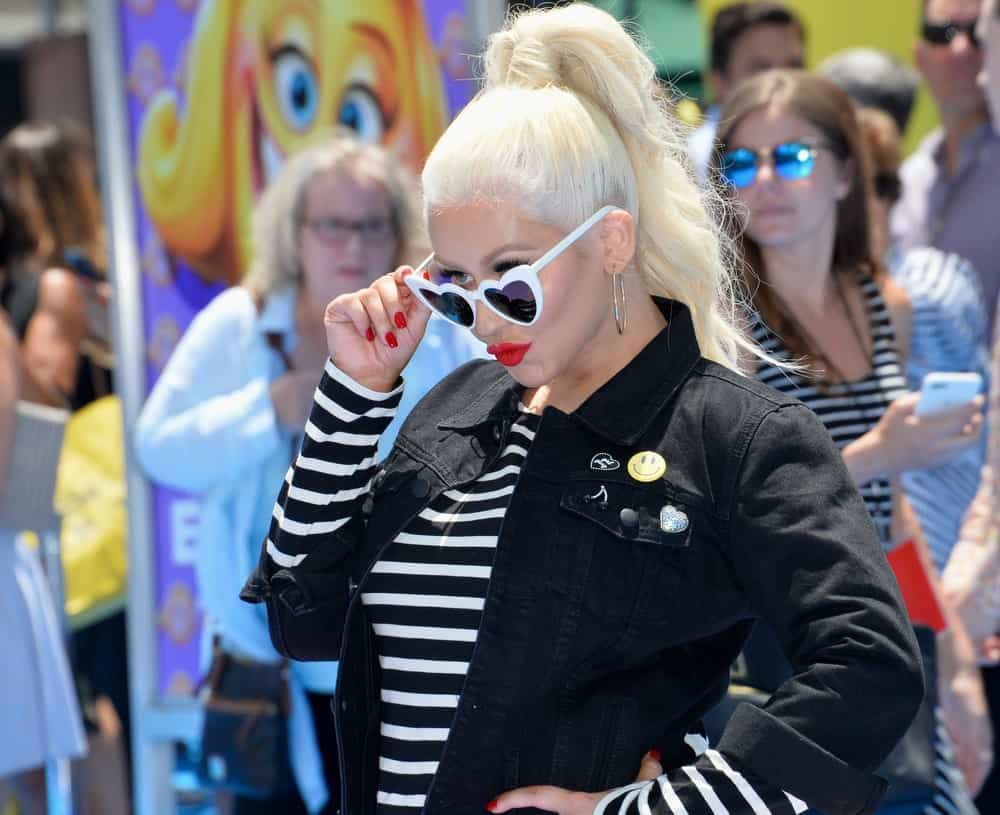 """Christina Aguilera looks playful with this long, high ponytail hairstyle at the """"The Emoji Movie"""" World Premiere on July 23, 2017."""