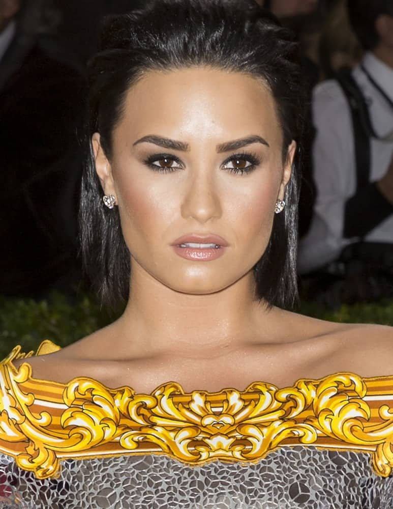 On May 2, 2016, Demi Lovato attended the Manus x Machina Fashion in an Age of Technology Costume Institute Gala at the Metropolitan Museum of Art. She was seen wearing a detailed dress to pair with her simple make-up and slicked back short raven hairstyle.