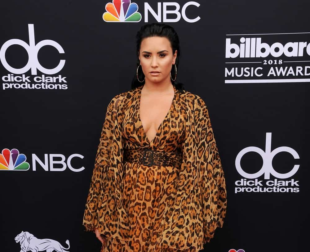 Demi Lovato wore an animal print dress with her slicked-back raven hairstyle at the 2018 Billboard Music Awards held at the MGM Grand Garden Arena in Las Vegas, USA on May 20, 2018.