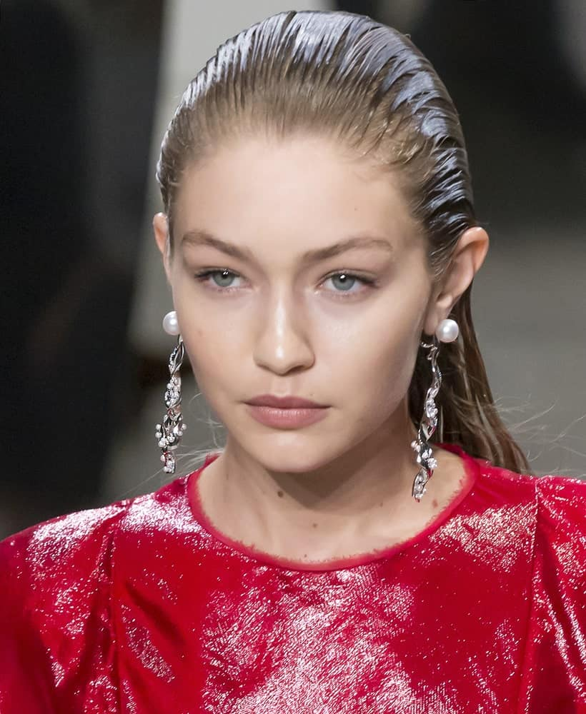 Gigi Hadid was dressed in a glittery red outfit and her hair was slicked back when she walked the runway at the Prabal Gurung Spring Summer 2018 fashion show during New York Fashion Week on September 10, 2017.