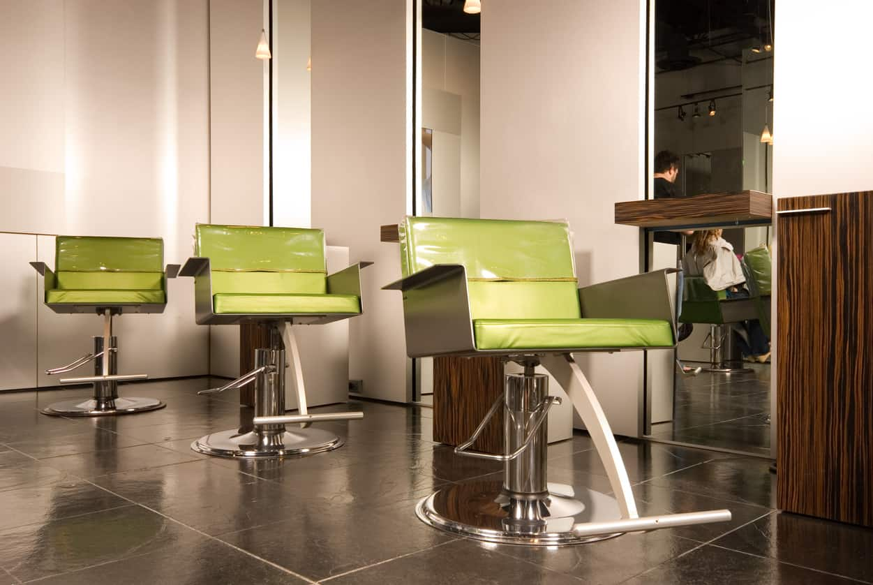 Lime green really draws the eye to it. This salon incorporated the bright hue without overdoing it. It is perfectly paired with the shelves and cupboards, and the stainless steel of the chairs finishes off the look. The dark tiled floors and plain white walls help pull this modern look together.