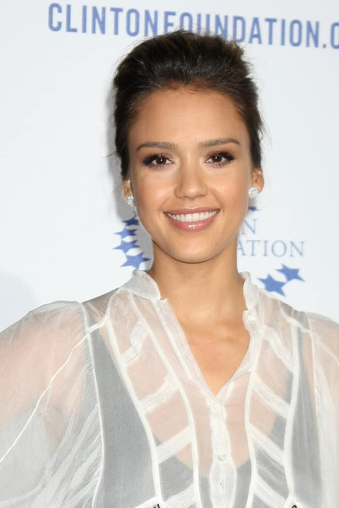 """Jessica Alba was quite charming in the white sheer outfit that she paired with an elegant upstyle bun hairstyle with slight tousle at the Clinton Foundation """"Decade of Difference"""" Gala at the Hollywood Palladium on October 14, 2011, in Los Angeles, CA."""