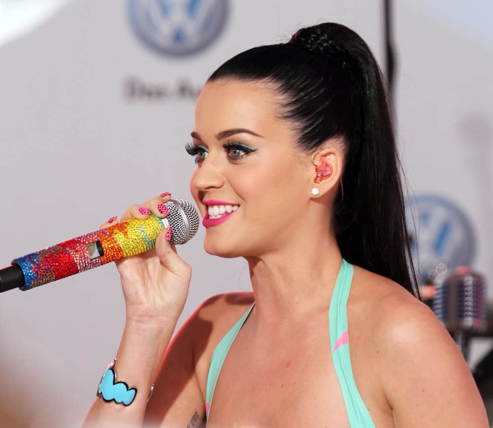 The singer performing at the world premiere of Volkswagen's new Jetta compact sedan at Times Square on June 15, 2010 with her long jet black hair slicked back into a high braided ponytail.