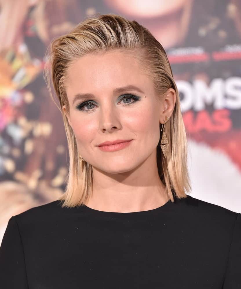 """Kristen Bell is a stunner at the """"A Bad Moms Christmas"""" Los Angeles Premiere on October 30, 2017, as she rocks a short slicked back hairstyle that complements her smokey eyes."""