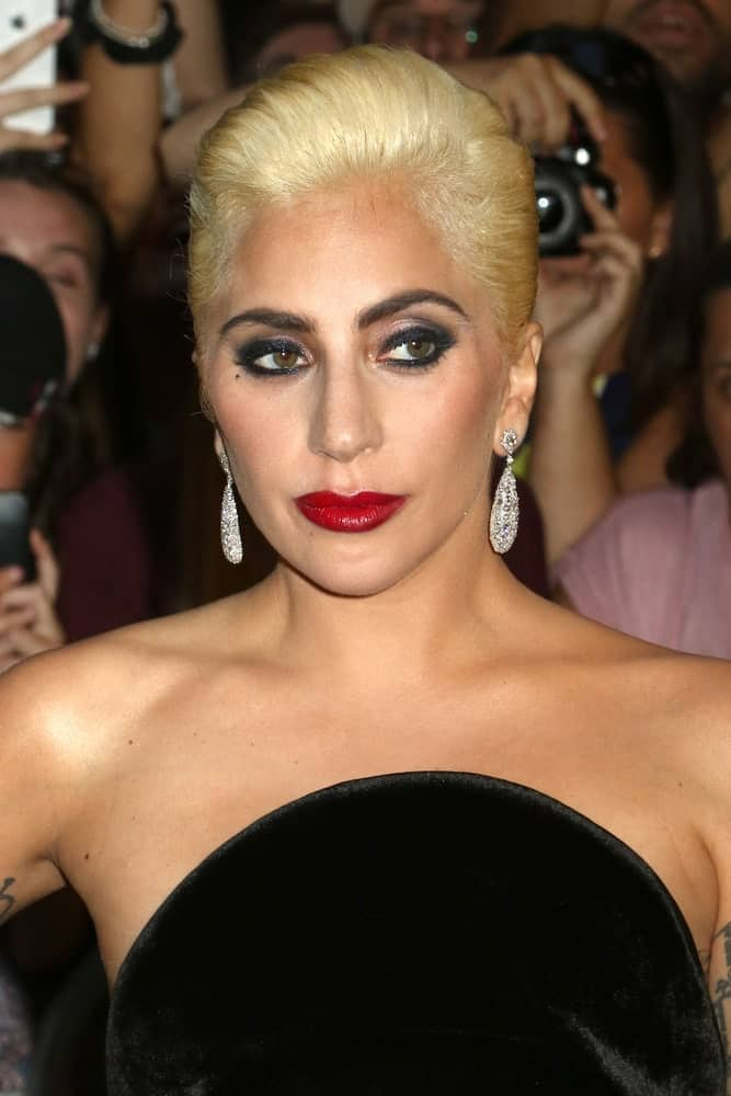 Lady Gaga opted for a vintage look to go with her beautiful black velvet dress. She wore a bold make-up and a neat slick upstyle when she was seen on August 3, 2016, in New York City.