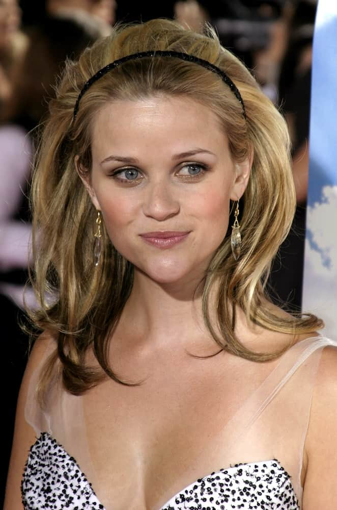 """Reese Witherspoon's thick and highlighted shoulder-length hairs were swept up by a headband for a classic look when she attended the """"Just Like Heaven"""" Los Angeles Premiere held at the Grauman's Chinese Theatre in Hollywood, California on September 8, 2005."""
