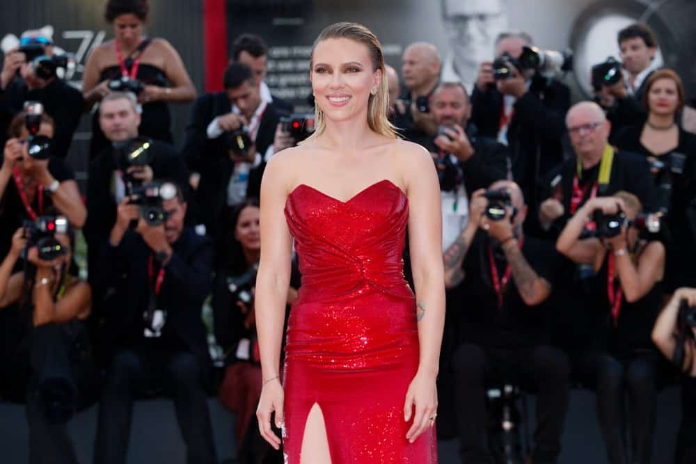 """Scarlett Johansson was perfectly breathtaking in her sexy red dress and slicked-back shoulder-length straight hair when she attended the premiere of the movie """"Marriage Story"""" during the 76th Venice Film Festival on August 29, 2019, in Venice, Italy."""